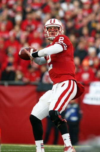 Nov 30, 2013; Madison, WI, USA; Wisconsin Badgers quarterback Joel Stave (2) drops back to pass during the game with Penn State at Camp Randall Stadium. Penn State defeated Wisconsin 31-24. Mandatory Credit: Mary Langenfeld-USA TODAY Sports