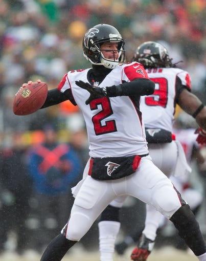 Dec 8, 2013; Green Bay, WI, USA; Atlanta Falcons quarterback Matt Ryan (2) during the game against the Green Bay Packers at Lambeau Field.  Green Bay won 22-21.  Mandatory Credit: Jeff Hanisch-USA TODAY Sports