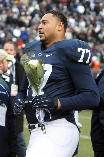 Nov 23, 2013; University Park, PA, USA; Penn State Nittany Lions tackle Garry Gilliam (77) during senior day recognition prior to the game against the Nebraska Cornhuskers at Beaver Stadium. Nebraska defeated Penn State 23-20 in overtime. Mandatory Credit: Matthew O'Haren-USA TODAY Sports