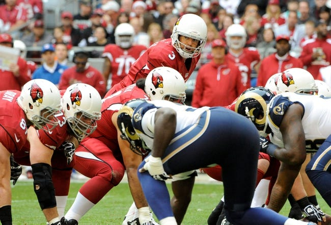 Dec 8, 2013; Phoenix, AZ, USA; Arizona Cardinals quarterback Carson Palmer (3) awaits the snap during the first quarter against the St. Louis Rams at University of Phoenix Stadium. Arizona won 30-10. Mandatory Credit: Casey Sapio-USA TODAY Sports