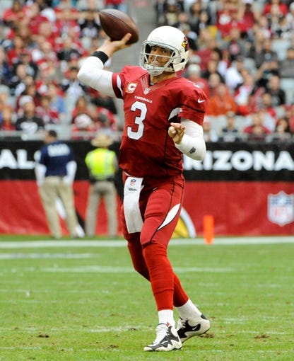 Dec 8, 2013; Phoenix, AZ, USA; Arizona Cardinals quarterback Carson Palmer (3) passes the ball during the second quarter against the St. Louis Rams at University of Phoenix Stadium. Arizona won 30-10. Mandatory Credit: Casey Sapio-USA TODAY Sports