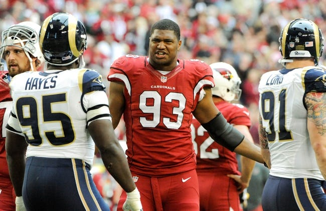 Dec 8, 2013; Phoenix, AZ, USA; Arizona Cardinals defensive end Calais Campbell (93) reacts as a play is being reviewed during the second quarter against the St. Louis Rams at University of Phoenix Stadium. Arizona won 30-10. Mandatory Credit: Casey Sapio-USA TODAY Sports