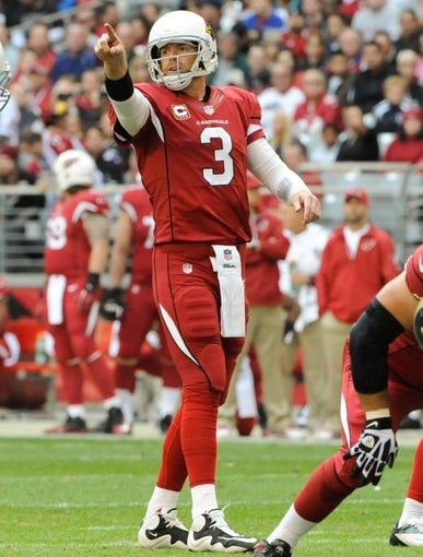 Dec 8, 2013; Phoenix, AZ, USA; Arizona Cardinals quarterback Carson Palmer (3) signals a play during the first quarter against the St. Louis Rams at University of Phoenix Stadium. Arizona won 30-10. Mandatory Credit: Casey Sapio-USA TODAY Sports