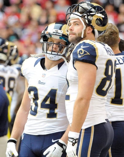 Dec 8, 2013; Phoenix, AZ, USA; St. Louis Rams running back Chase Reynolds (34) and tight end Mike McNeill (82) talk on the sidelines during the second quarter against the Arizona Cardinals at University of Phoenix Stadium. Arizona won 30-10. Mandatory Credit: Casey Sapio-USA TODAY Sports