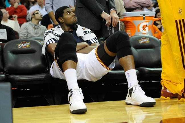 Dec 10, 2013; Cleveland, OH, USA; Cleveland Cavaliers center Andrew Bynum sits on the bench during a game against the New York Knicks at Quicken Loans Arena. Cleveland won 109-94. Mandatory Credit: David Richard-USA TODAY Sports