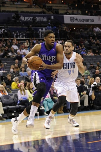 Dec 17, 2013; Charlotte, NC, USA; Sacramento Kings forward Rudy Gay (8) drives past Charlotte Bobcats forward Jeffery Taylor (44) during the first half of the game at Time Warner Cable Arena. Mandatory Credit: Sam Sharpe-USA TODAY Sports