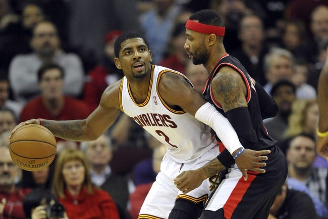 Dec 17, 2013; Cleveland, OH, USA; Cleveland Cavaliers point guard Kyrie Irving (2) dribbles against Portland Trail Blazers point guard Mo Williams (25) in the first quarter at Quicken Loans Arena. Mandatory Credit: David Richard-USA TODAY Sports