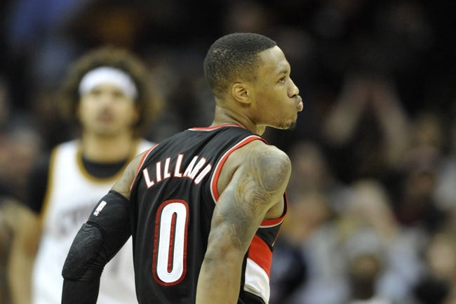 Dec 17, 2013; Cleveland, OH, USA; Portland Trail Blazers point guard Damian Lillard (0) reacts after making a game-winning, three-point basket against the Cleveland Cavaliers at Quicken Loans Arena. Mandatory Credit: David Richard-USA TODAY Sports