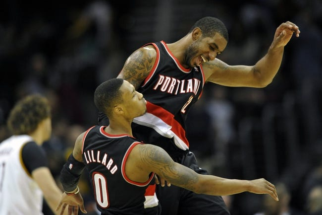 Dec 17, 2013; Cleveland, OH, USA; Portland Trail Blazers power forward LaMarcus Aldridge (right) celebrates with point guard Damian Lillard (0) after Lillard's game-winning, three-point basket at Quicken Loans Arena. Mandatory Credit: David Richard-USA TODAY Sports
