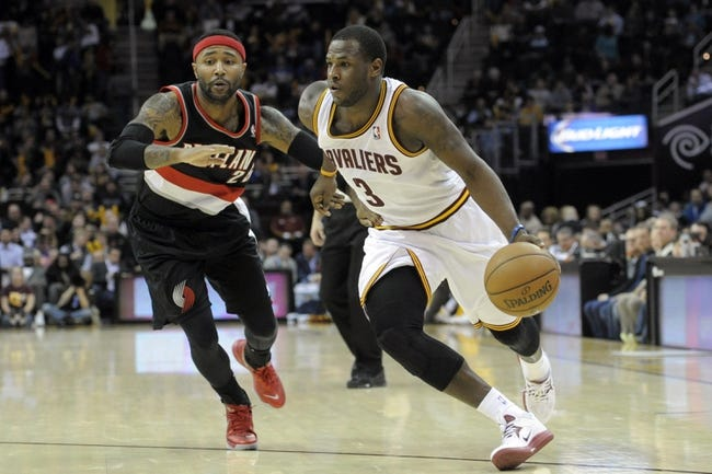 Dec 17, 2013; Cleveland, OH, USA; Cleveland Cavaliers shooting guard Dion Waiters (3) drives against Portland Trail Blazers point guard Mo Williams (25) in the fourth quarter at Quicken Loans Arena. Mandatory Credit: David Richard-USA TODAY Sports