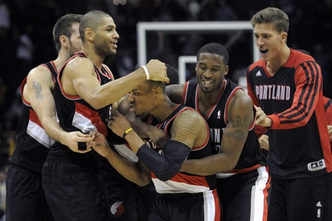 Dec 17, 2013; Cleveland, OH, USA; Portland Trail Blazers point guard Damian Lillard (center) is swarmed by his teammates after making a game-winning, three-point basket against the Cleveland Cavaliers at Quicken Loans Arena. Mandatory Credit: David Richard-USA TODAY Sports