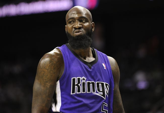 Dec 17, 2013; Charlotte, NC, USA; Sacramento Kings forward Quincy Acy (5) after being fouled by Charlotte Bobcats forward Cody Zeller (40) (not pictured) during the second half of the game at Time Warner Cable Arena. Bobcats win 95-87. Mandatory Credit: Sam Sharpe-USA TODAY Sports