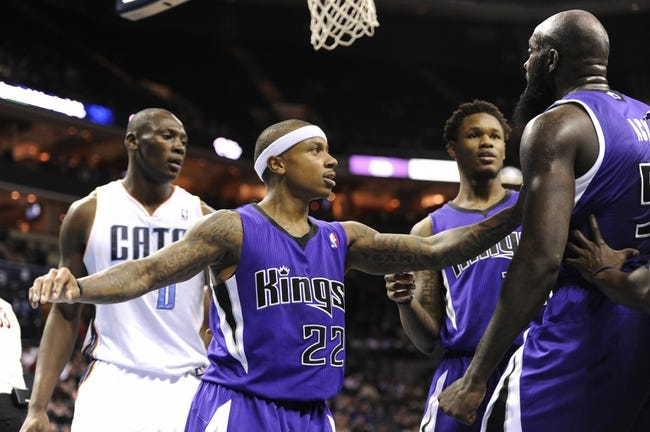 Dec 17, 2013; Charlotte, NC, USA; Sacramento Kings guard Isaiah Thomas (22) holds back forward Quincy Acy (5) from getting into an altercation with Charlotte Bobcats forward Bismack Biyombo (0) and forward Cody Zeller (40) (not pictured) during the second half of the game at Time Warner Cable Arena. Bobcats win 95-87. Mandatory Credit: Sam Sharpe-USA TODAY Sports
