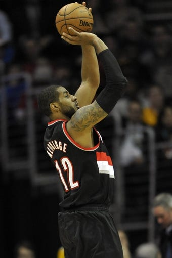 Dec 17, 2013; Cleveland, OH, USA; Portland Trail Blazers power forward LaMarcus Aldridge shoots in the third quarter against the Cleveland Cavaliers at Quicken Loans Arena. Mandatory Credit: David Richard-USA TODAY Sports