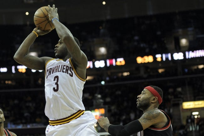 Dec 17, 2013; Cleveland, OH, USA; Cleveland Cavaliers shooting guard Dion Waiters (3) shoots against Portland Trail Blazers point guard Mo Williams (25) in the fourth quarter at Quicken Loans Arena. Mandatory Credit: David Richard-USA TODAY Sports