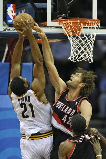 Dec 17, 2013; Cleveland, OH, USA; Portland Trail Blazers center Robin Lopez (42) blocks a shot against Cleveland Cavaliers center Andrew Bynum (21) in the second quarter at Quicken Loans Arena. Mandatory Credit: David Richard-USA TODAY Sports