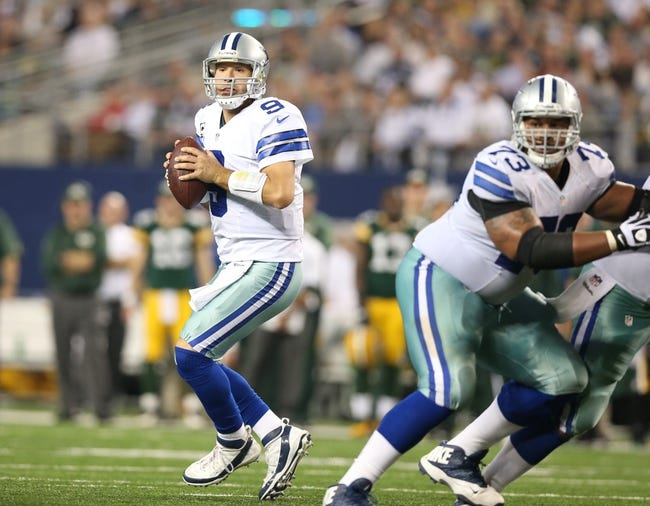 Dec 15, 2013; Arlington, TX, USA; Dallas Cowboys quarterback Tony Romo (9) throws in the pocket against the Green Bay Packers at AT&T Stadium. Mandatory Credit: Matthew Emmons-USA TODAY Sports