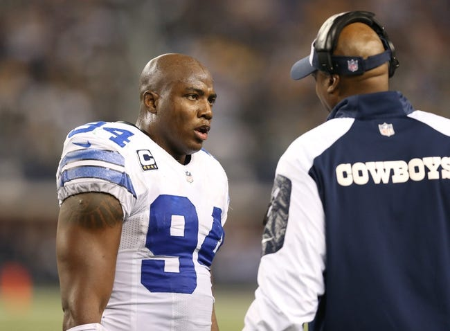 Dec 15, 2013; Arlington, TX, USA; Dallas Cowboys defensive end DeMarcus Ware (94) talks with defensive line coach Leon Lett during the game against the Green Bay Packers at AT&T Stadium. Mandatory Credit: Matthew Emmons-USA TODAY Sports