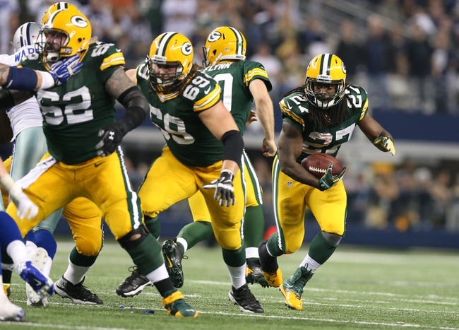 Dec 15, 2013; Arlington, TX, USA; Green Bay Packers running back Eddie Lacy (27) runs with the ball with lead blocking provided by tackle David Bakhtiari (69) and center Evan Dietrich-Smith (62) against the Dallas Cowboys at AT&T Stadium. Mandatory Credit: Matthew Emmons-USA TODAY Sports