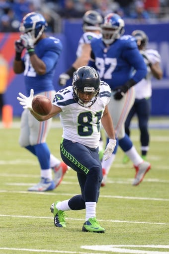 Dec 15, 2013; East Rutherford, NJ, USA; Seattle Seahawks wide receiver Golden Tate (81) celebrates a catch against the New York Giants at MetLife Stadium. The Seahawks won the game 23-0. Mandatory Credit: Joe Camporeale-USA TODAY Sports