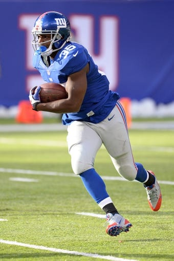 Dec 15, 2013; East Rutherford, NJ, USA; New York Giants running back Andre Brown (35) runs the ball against the Seattle Seahawks at MetLife Stadium. The Seahawks won the game 23-0. Mandatory Credit: Joe Camporeale-USA TODAY Sports