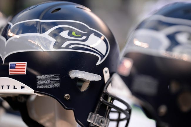 Dec 15, 2013; East Rutherford, NJ, USA; A look at a Seattle Seahawks helmet at the bench area against the New York Giants at MetLife Stadium. The Seahawks won the game 23-0. Mandatory Credit: Joe Camporeale-USA TODAY Sports