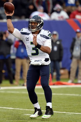Dec 15, 2013; East Rutherford, NJ, USA; Seattle Seahawks quarterback Russell Wilson (3) throws a pass against the New York Giants at MetLife Stadium. The Seahawks won the game 23-0. Mandatory Credit: Joe Camporeale-USA TODAY Sports