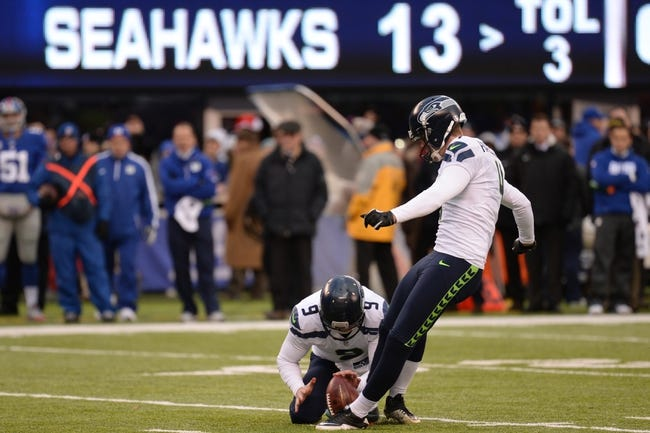 Dec 15, 2013; East Rutherford, NJ, USA; Seattle Seahawks kicker Steven Hauschka (4) kicks a field goal against the New York Giants at MetLife Stadium. The Seahawks won the game 23-0. Mandatory Credit: Joe Camporeale-USA TODAY Sports