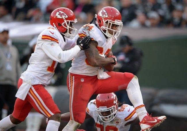 Dec 15, 2013; Oakland, CA, USA; Kansas City Chiefs running back Knile Davis (34) celebrates with receiver Donnie Avery (17) after scoring on a 17-yard touchdown reception in the fourth quarter against the Oakland Raiders at O.co Coliseum. The Chiefs defeated the Raiders 56-31. Mandatory Credit: Kirby Lee-USA TODAY Sports
