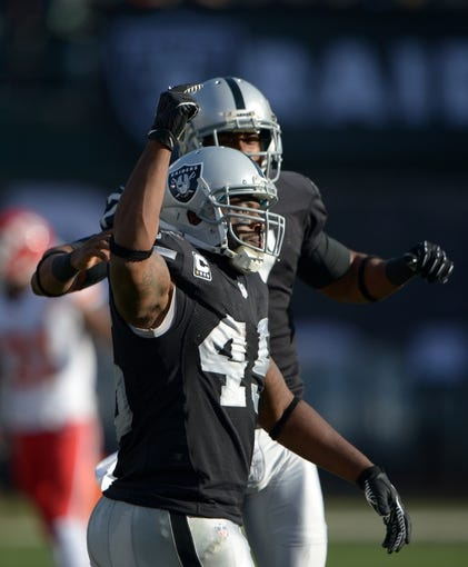 Dec 15, 2013; Oakland, CA, USA; Oakland Raiders fullback Marcel Reece (45) and punter Marquette King (7) celebrate after a first down on a fake punt against the Kansas City Chiefs at O.co Coliseum. The Chiefs defeated the Raiders 56-31. Mandatory Credit: Kirby Lee-USA TODAY Sports