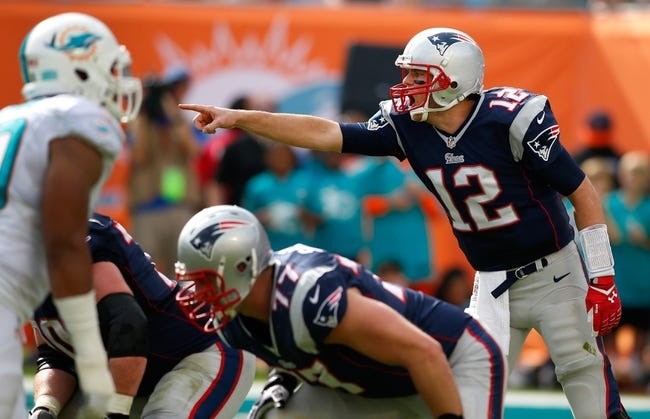 Dec 15, 2013; Miami Gardens, FL, USA: New England Patriots quarterback Tom Brady (12) points out coverage in the second quarter of a game against the Miami Dolphins at Sun Life Stadium. Mandatory Credit: Robert Mayer-USA TODAY Sports