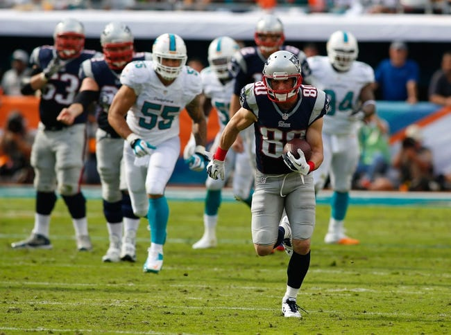 Dec 15, 2013; Miami Gardens, FL, USA: New England Patriots wide receiver Danny Amendola (80) runs with the ball against the Miami Dolphins in the second quarter at Sun Life Stadium. Mandatory Credit: Robert Mayer-USA TODAY Sports