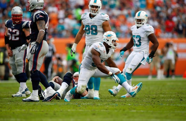 Dec 15, 2013; Miami Gardens, FL, USA: Miami Dolphins defensive end Cameron Wake (91) reacts after a sack on New England Patriots quarterback Tom Brady (12) in the second half at Sun Life Stadium. The Dolphins won 24-20. Mandatory Credit: Robert Mayer-USA TODAY Sports