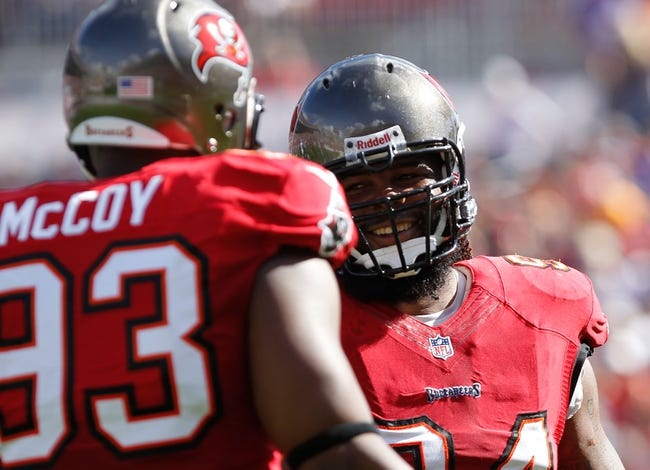 Dec 8, 2013; Tampa, FL, USA; Tampa Bay Buccaneers defensive end Adrian Clayborn (94) smiles with defensive tackle Gerald McCoy (93)  during the first quarter against the Buffalo Bills at Raymond James Stadium. Mandatory Credit: Kim Klement-USA TODAY Sports