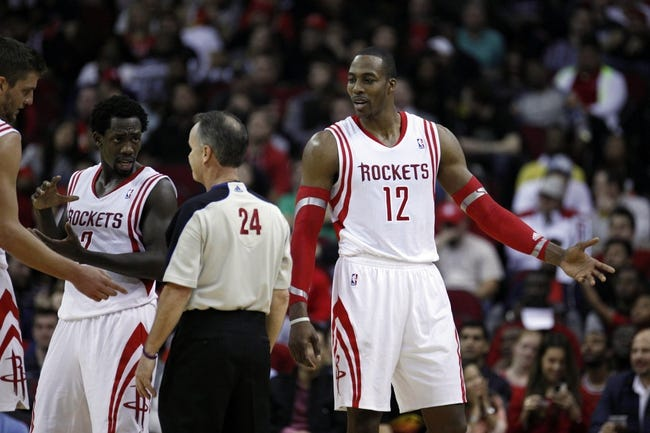 Dec 18, 2013; Houston, TX, USA; Houston Rockets power forward Dwight Howard (12) argues with referee Mike Callahan (24) during the second quarter against the Chicago Bulls at Toyota Center. Mandatory Credit: Andrew Richardson-USA TODAY Sports