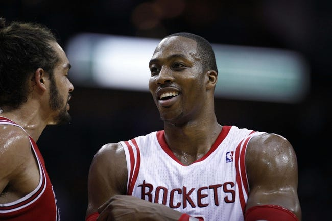 Dec 18, 2013; Houston, TX, USA; Houston Rockets power forward Dwight Howard (12) talks to Chicago Bulls center Joakim Noah (13) during the second quarter at Toyota Center. Mandatory Credit: Andrew Richardson-USA TODAY Sports