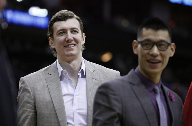 Dec 18, 2013; Houston, TX, USA; Houston Rockets center Omer Asik (3) and point guard Jeremy Lin (7) walk to the locker room during halftime at Toyota Center. Mandatory Credit: Andrew Richardson-USA TODAY Sports