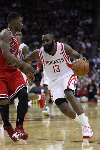 Dec 18, 2013; Houston, TX, USA; Houston Rockets shooting guard James Harden (13) with the ball against Chicago Bulls shooting guard Jimmy Butler (21) during the second quarter at Toyota Center. Mandatory Credit: Andrew Richardson-USA TODAY Sports