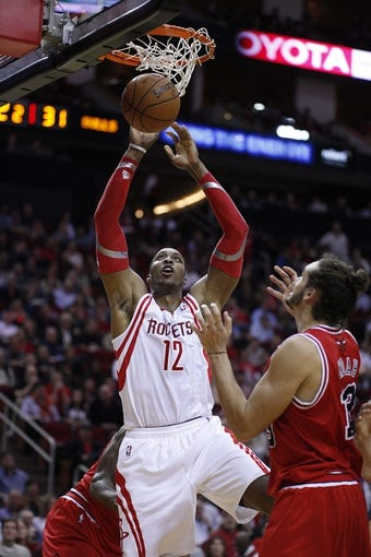 Dec 18, 2013; Houston, TX, USA; Houston Rockets power forward Dwight Howard (12) dunks the ball during the second quarter against the Chicago Bulls at Toyota Center. Mandatory Credit: Andrew Richardson-USA TODAY Sports