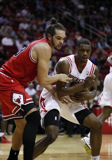 Dec 18, 2013; Houston, TX, USA; Houston Rockets power forward Terrence Jones (6) and Chicago Bulls center Joakim Noah (13) fight for the rebound during the third quarter at Toyota Center. Mandatory Credit: Andrew Richardson-USA TODAY Sports
