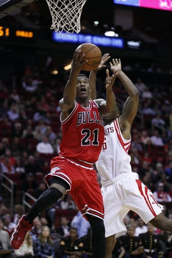 Dec 18, 2013; Houston, TX, USA; Chicago Bulls shooting guard Jimmy Butler (21) shoots the ball during the third quarter against the Houston Rockets at Toyota Center. Mandatory Credit: Andrew Richardson-USA TODAY Sports