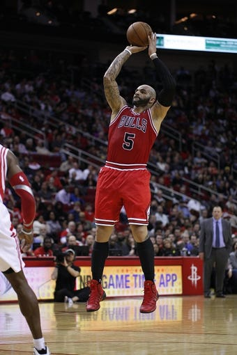 Dec 18, 2013; Houston, TX, USA; Chicago Bulls power forward Carlos Boozer (5) shoots the ball during the third quarter against the Houston Rockets at Toyota Center. Mandatory Credit: Andrew Richardson-USA TODAY Sports