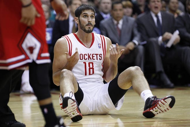 Dec 18, 2013; Houston, TX, USA; Houston Rockets small forward Omri Casspi (18) reacts to a play during the third quarter against the Chicago Bulls at Toyota Center. Mandatory Credit: Andrew Richardson-USA TODAY Sports