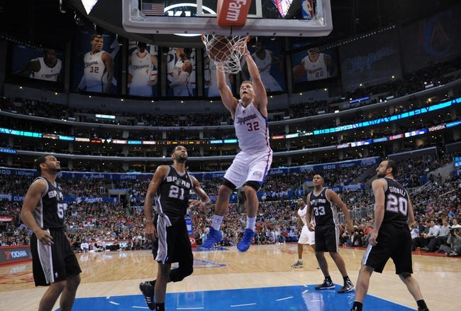 Dec 16, 2013; Los Angeles, CA, USA; Los Angeles Clippers forward Blake Griffin (32) dunks the ball as San Antonio Spurs players Cory Joseph (5), Tim Duncan (21), Boris Diaw (33) and Manu Ginobili (20) watch at Staples Center. The Clippers defeated the Spurs 115-92. Mandatory Credit: Kirby Lee-USA TODAY Sports