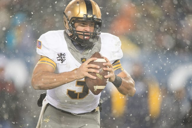 Dec 14, 2013; Philadelphia, PA, USA; Army Black Knights quarterback Angel Santiago (3) runs with the ball during  the 114th Army-Navy game at Lincoln Financial Field. Navy Midshipmen defeated Army Black Knights 34-7. Mandatory Credit: Tommy Gilligan-USA TODAY Sports