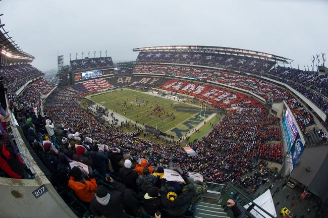 Dec 14, 2013; Philadelphia, PA, USA; The attendees of the  114th Army-Navy game conduct a Card Stunt prior to the game at Lincoln Financial Field. Navy Midshipmen defeated Army Black Knights 34-7. Mandatory Credit: Tommy Gilligan-USA TODAY Sports