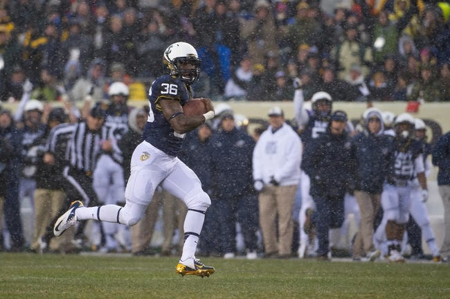 Dec 14, 2013; Philadelphia, PA, USA; Navy Midshipmen fullback Quinton Singleton (36) runs with the ball during  the 114th Army-Navy game at Lincoln Financial Field. Navy Midshipmen defeated Army Black Knights 34-7. Mandatory Credit: Tommy Gilligan-USA TODAY Sports