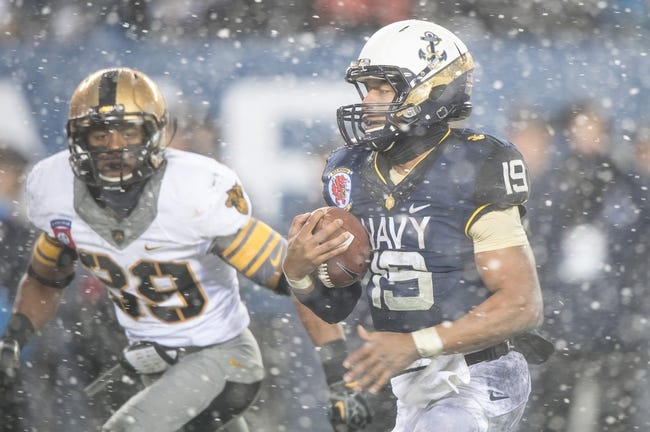 Dec 14, 2013; Philadelphia, PA, USA; Navy Midshipmen quarterback Keenan Reynolds (19) runs with the ball past Army Black Knights defensive back Josh Jenkins (39)  for a touchdown during  the 114th Army-Navy game at Lincoln Financial Field. Navy Midshipmen defeated Army Black Knights 34-7. Mandatory Credit: Tommy Gilligan-USA TODAY Sports