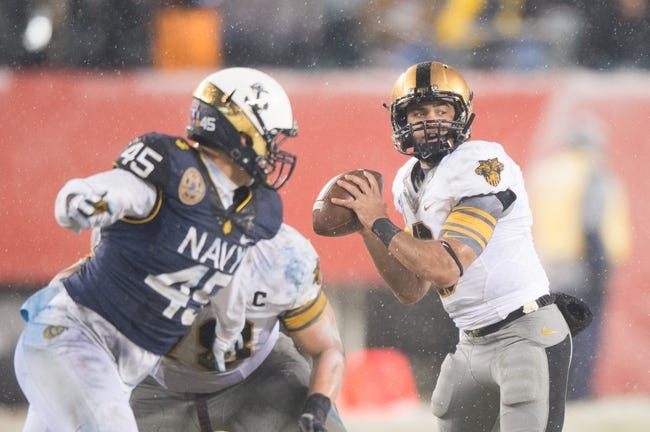 Dec 14, 2013; Philadelphia, PA, USA; Army Black Knights quarterback Angel Santiago (3) throws the ball from the pocket during  the 114th Army-Navy game at Lincoln Financial Field. Navy Midshipmen defeated Army Black Knights 34-7. Mandatory Credit: Tommy Gilligan-USA TODAY Sports