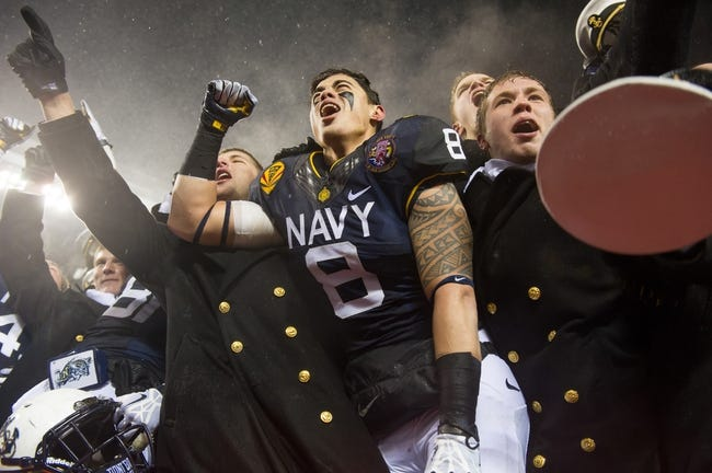 Dec 14, 2013; Philadelphia, PA, USA; Navy Midshipmen safety Wave Ryder (8) and his classmates celebrate after the 114th Army-Navy game at Lincoln Financial Field. Navy Midshipmen defeated Army Black Knights 34-7. Mandatory Credit: Tommy Gilligan-USA TODAY Sports